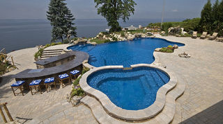 , Vinyl pool with 3 sets of stairs large vinyl spa bar stool in the pool vanishing edge benches swim up bar and 2 waterfalls