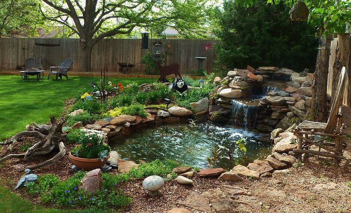 Cleaned the pond added plants Asia in her favorite spot :)