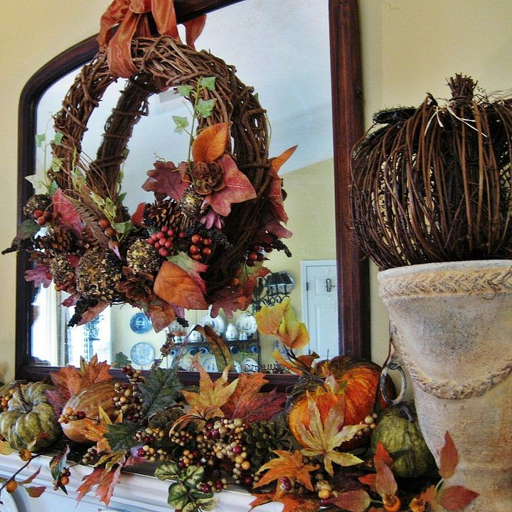 The wreath from several years ago came down from my attic and...woo hoo...looks great with a newer garland!