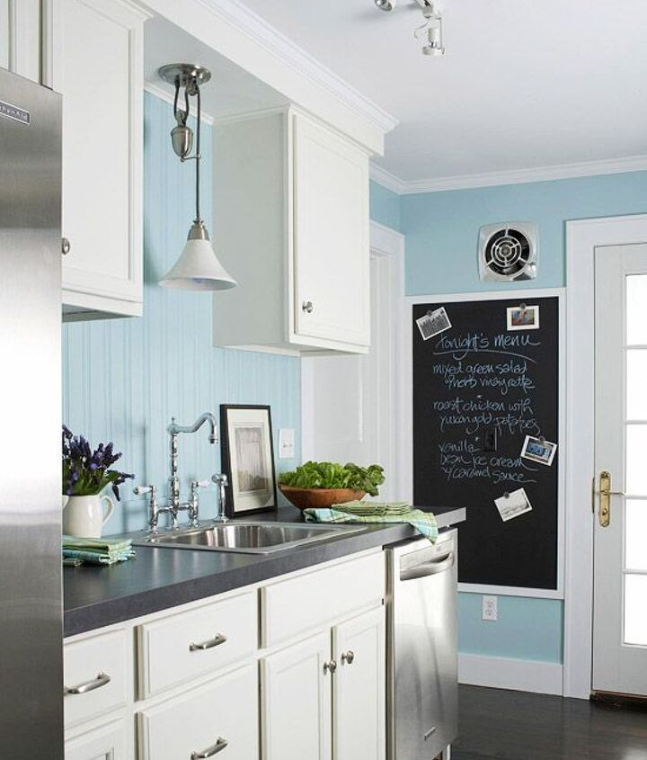 Sky blue walls change this kitchen completely against the all white cabinets and gray counter tops.