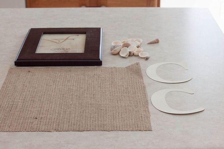 My supplies included a frame, some small shells, a sheet of burlap, and a stock paper C.