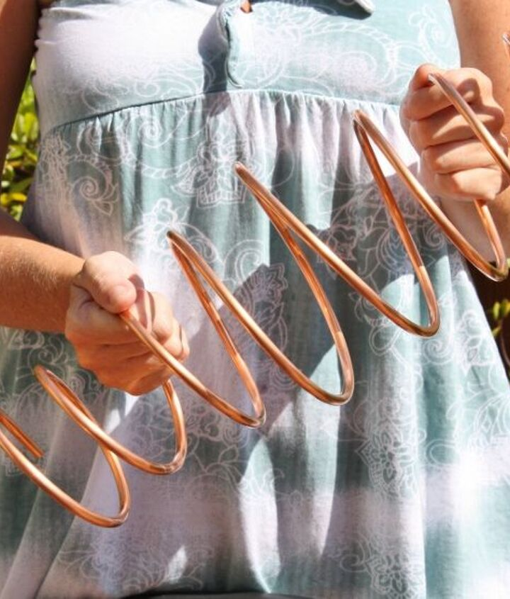 Bending and twisting copper tubing to make a mobile for the garden, porch, or deck.