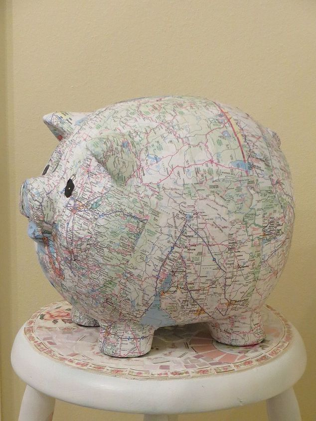 covered my pig bank in maps, crafts, decoupage