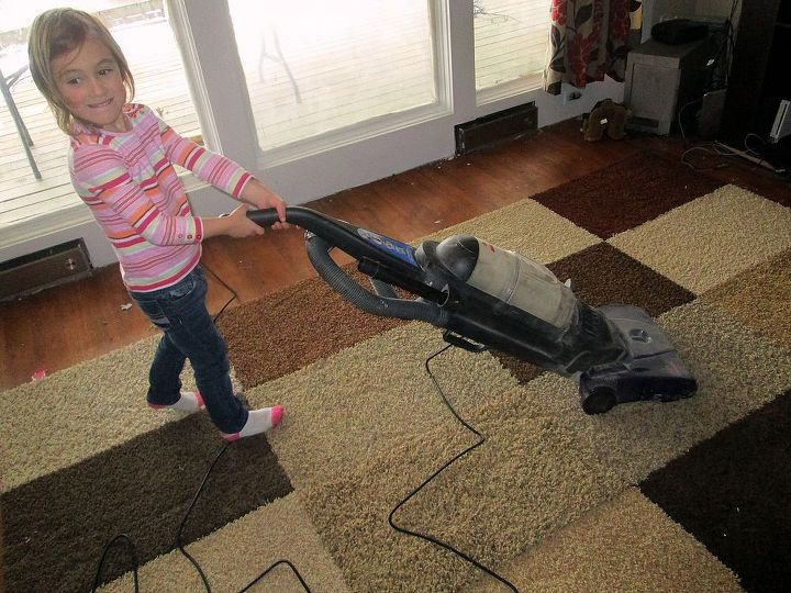 Give the rug the vacuum treatment.