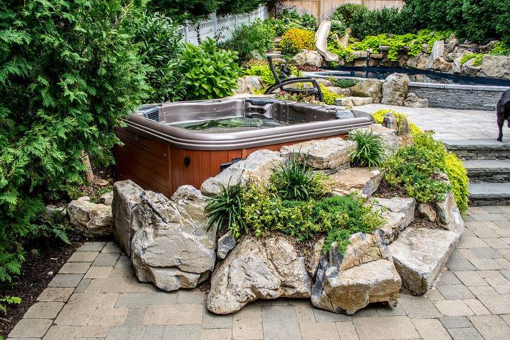 Bullfrog spa built into boulders and colorful plantings
