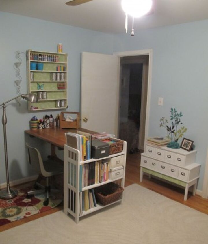 How my craft room look so far. It's coming along nicely! It contains a thrifted vintage drafting table, a DIY card catalog, and a thrifted shelf.