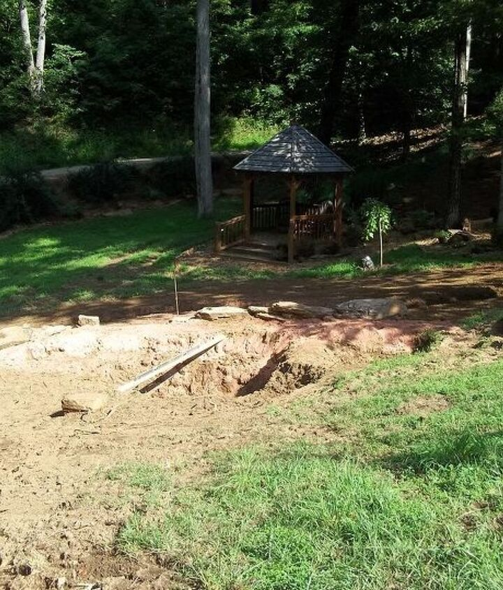 the first picture was from the ponds  up to the pergola and house...this one is across the other way where the path will end at the gazebo..hoping you can see 2 holes, bigger 1 and smaller one, in between will be a bridge.