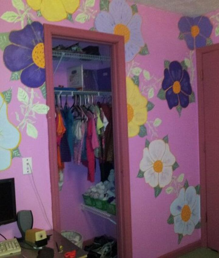 Her closet, shelves on both sides to hold her clothes so there is no need for a dresser in her room. I painted the flowers to resemble a vine covered wall.