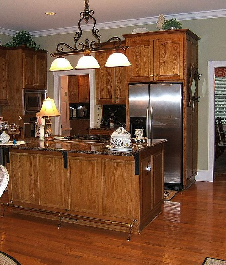 Before- Oak cabinets and island. Baltic Brown granite-