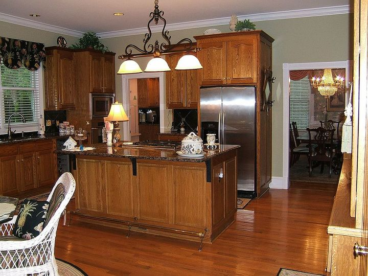 Before- Oak cabinets and island. Baltic Brown granite-