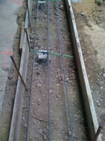 Rebar is placed and the footing is ready for concrete.