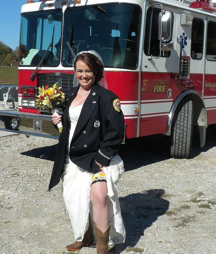 The Bride in her finery, wearing her fireman fiance's uniform jacket.