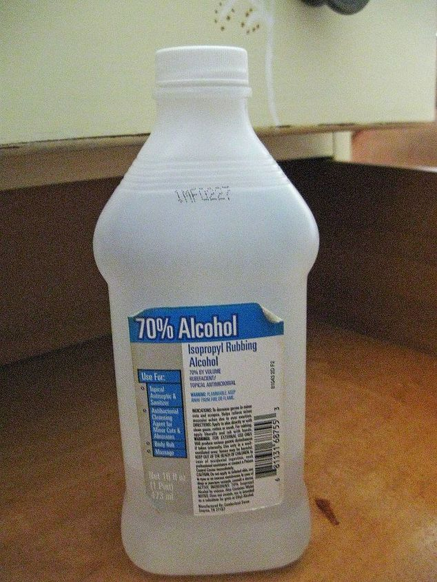 Use your typical household rubbing alcohol and a clean cloth.