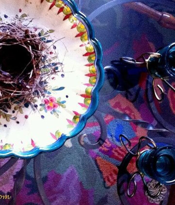 A birds nest is the perfect juxtaposition to the hand-painted plate I brought home from Italy.  The glass top coffee table provides the perfect view to my colorful rug.