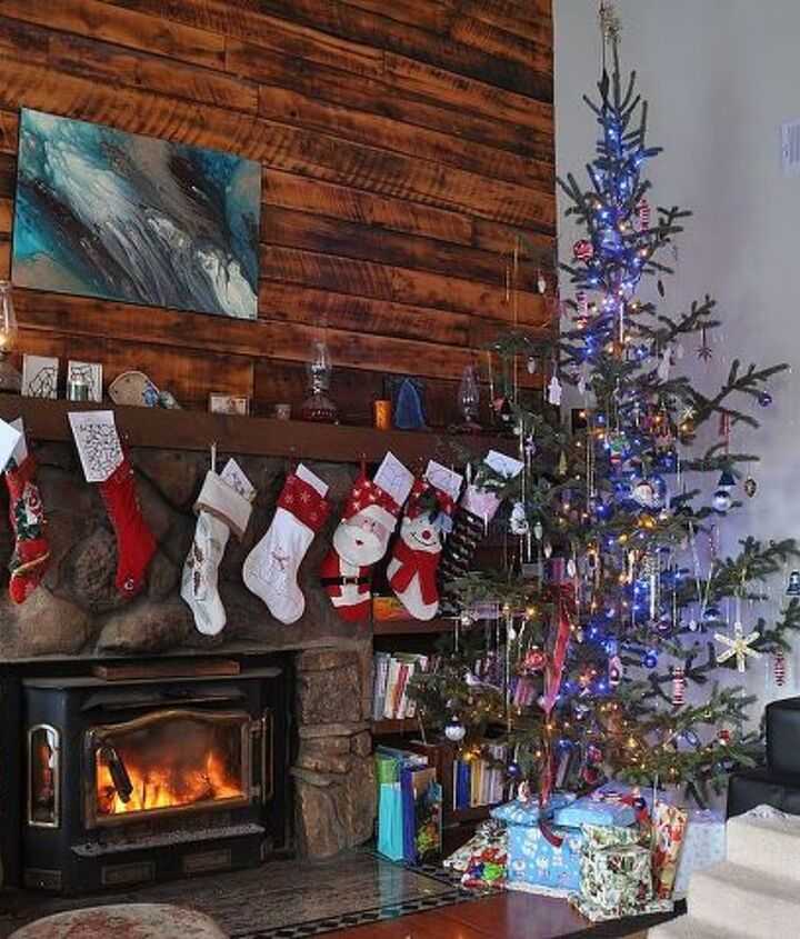Our 10 foot tree and 11 stockings hung by the fire with care.