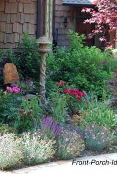 landscaping around your porch, curb appeal, flowers, landscape, The corner of a porch and walkway becomes a focal point with the addition of a bird house small shrubs and perennial flowers