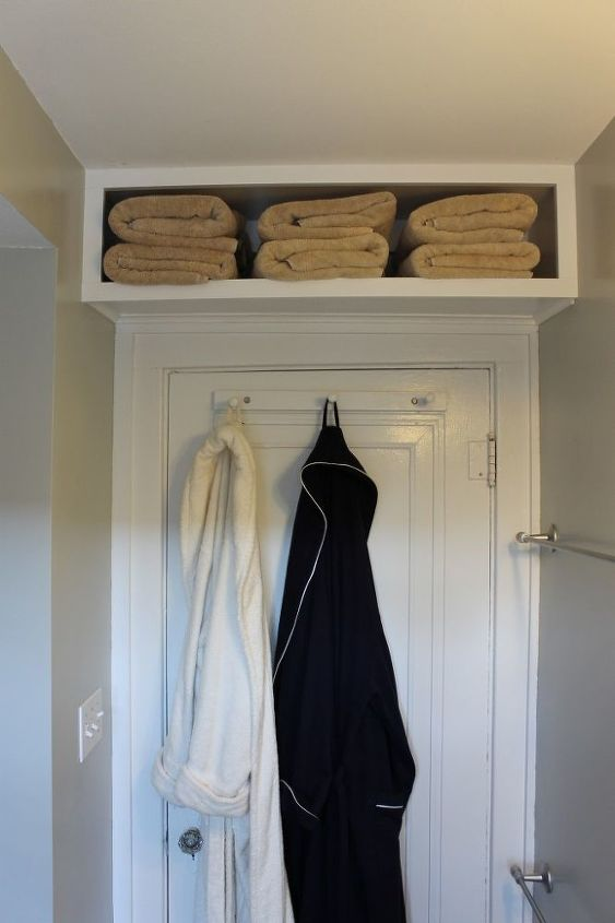 Look up for more storage.  We built this shelf over our bathroom door for our extra towels.  It was really easy.