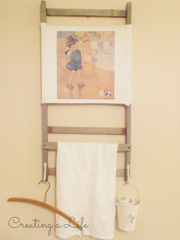 vintage beach chair to vintage beach inspired towel rack, diy, repurposing upcycling, woodworking projects, Since this photo I ve added two hangers to the back already had those