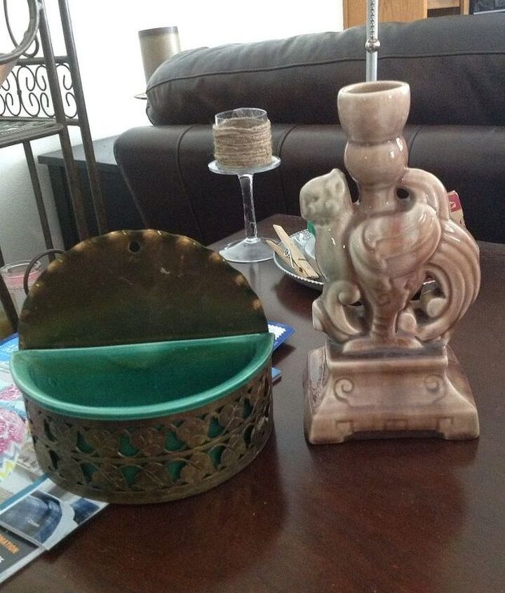 Yes, a wall pocket and a griffin candle holder!  Score!