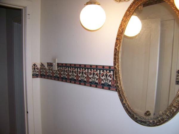 Hanging globe lighting and mirrored in wall medicine cabinet with ugly border was so outdated