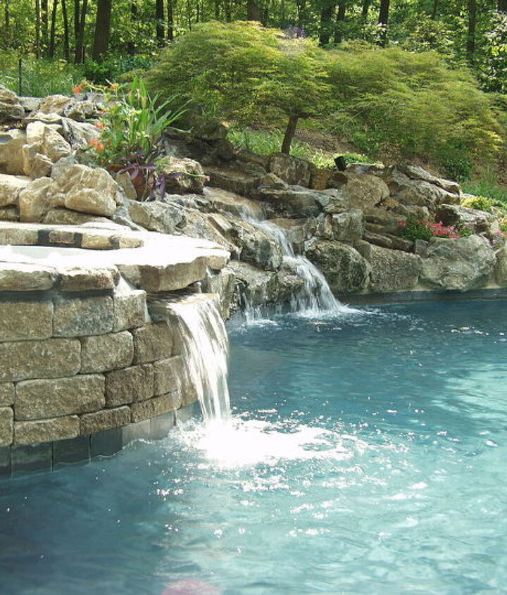 Techo Bloc walls edge the spa and pool connection. www.deckandpatio.com