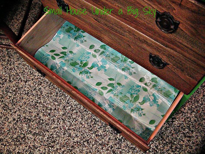 I lined the drawers using a blue/green vintage looking flower print wrapping paper.