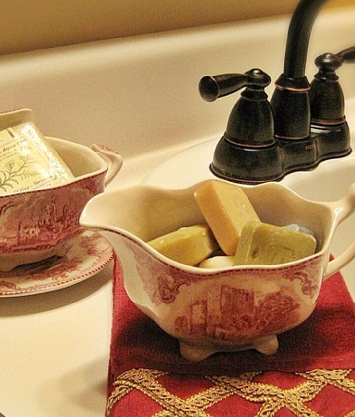 An unexpected touch...a red transferware creamer and sugar hold miniature French milled soaps.