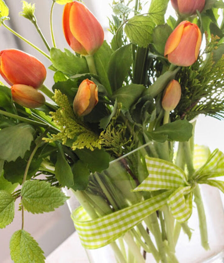 Have you ever noticed those  beautiful bunches of tulips at the grocery store, but sure what to do with them? For $5 bring them home and add some greens from your own yard to make them really sing!