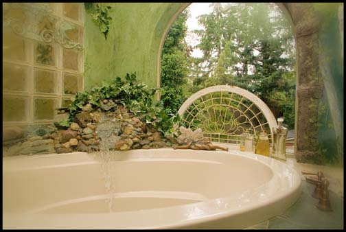 I had my plumbing come up high and in the corner then sculptured a rock waterfall to fill the tub. SK Sartell