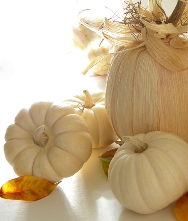 Use real white pumpkins and fake pumpkins covered in cornhusk for your fall decor.