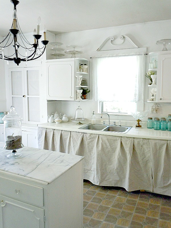 The cabinets are a little wonky as they tend to be in old farmhouses so we covered it with a painters drop cloth.