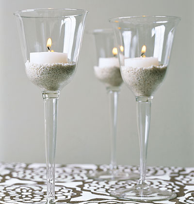 """5. Wine Glasses -  Tea Candle holders. A little sand, a little light and the """"Vois la!"""" you have some new accent decor for your living room, bedroom, bathroom or entryway!"""