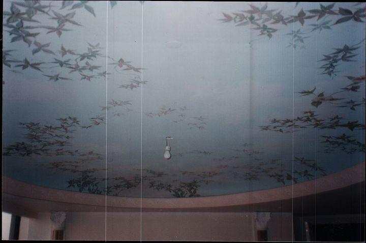 Painted ceiling in a ladies bedroom