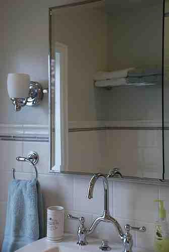 Shiny fixtures and reflective mirrors keep things feeling bright