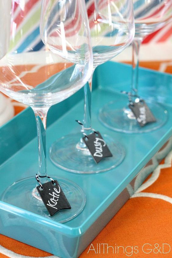 Michaels' mini chalkboard pennants also make fantastic, reusable wine charms!  Just scribble a name and tie them on!