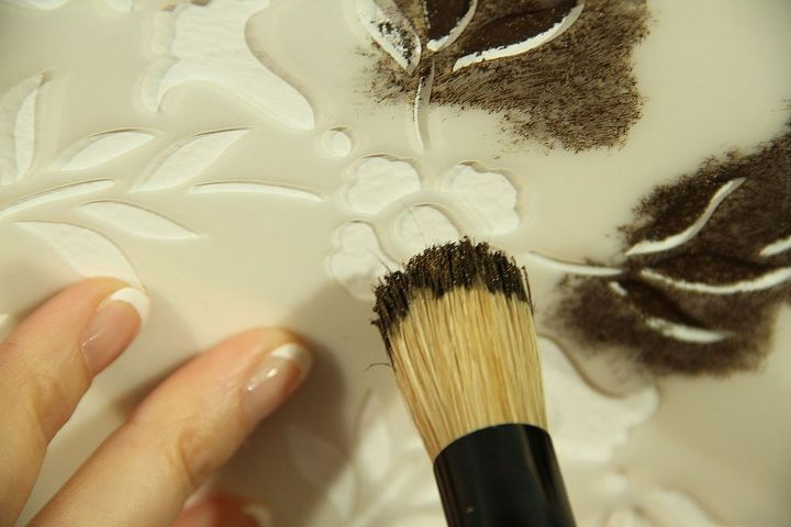 Put brush into stencil paint, off-load onto paper towel & pounce to fill in design.