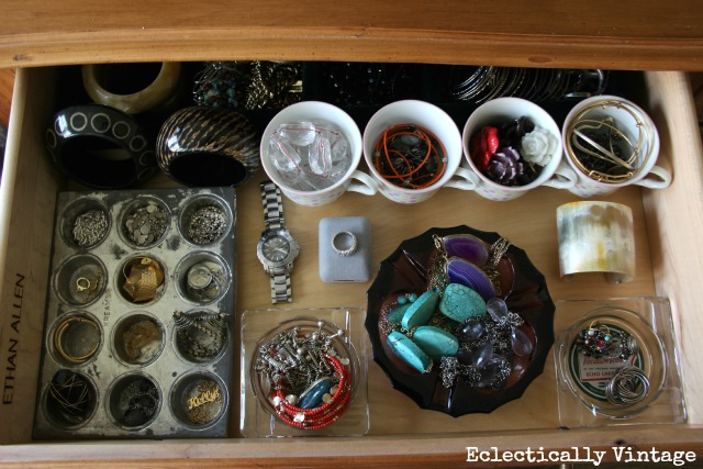 Forget plastic dividers - from vintage teacups, ashtrays and muffin tins, my storage is as pretty as my jewelry.  See more at http://eclecticallyvintage.com/2013/01/mission-organization-jewelry-drawer/