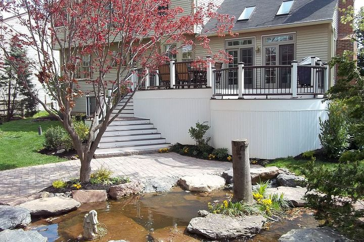 Curved deck and pond compliment one another: Lentzcaping considers flow and function when designing water gardens