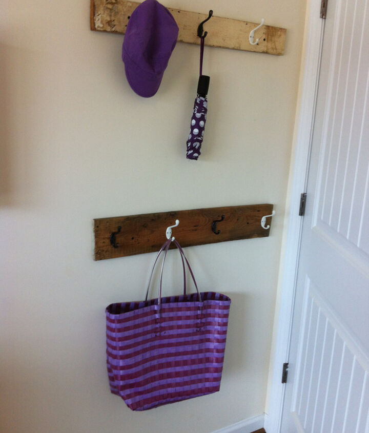 Some extra storage was added behind the bedroom door by means of two reclaimed boards and different coloured hooks. Tip: you can't see the clutter when the door is wide open!
