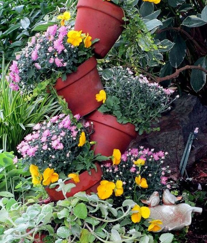 Just updated the spring tipsy-pots planter for fall by adding fall pansies, small mums, plectranthus and a little curry plant. See more pictures at http://ourfairfieldhomeandgarden.com/diy-project-build-your-own-tipsy-pots-planter