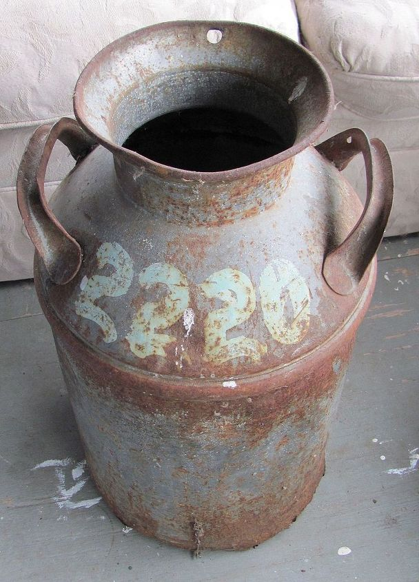 Very rough milk can formerly used to store garden tools upright......