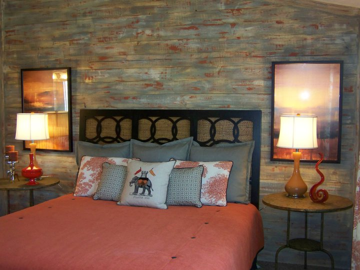 Atlanta designer Angela Hogan had raw wood applied to the bed wall and then I used a three step aging process to get a weathered look that also incorporated the dominant colors in the bedding. The builder was worried at first but loved it after all the painting and decor was in place.  Beazer Homes/ Houston, TX