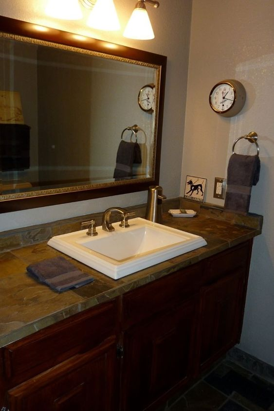 One last thing to add to the recently remodeled bathroom.. Glass mosaic tile behind the mirror