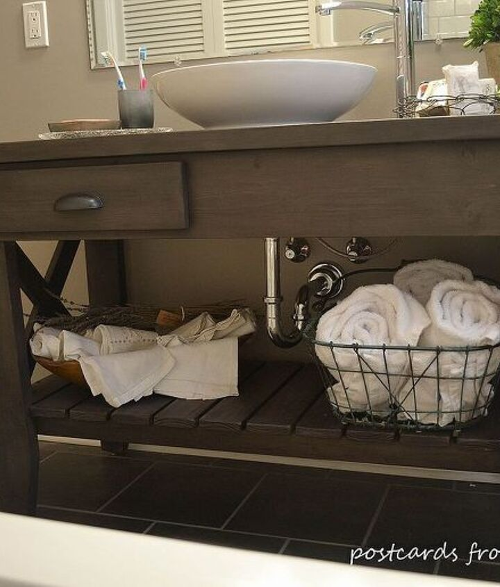 The vanity was built from pine and had a custom finish applied to it.