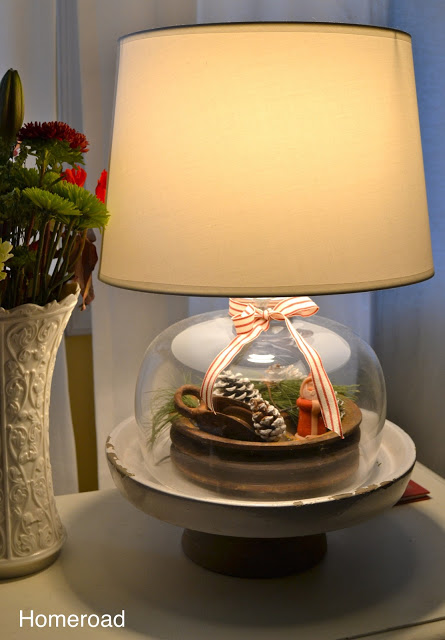 The cloche lamp sits on a pedestal to give it more height.