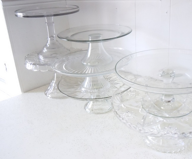 Cake plate collection lines the upper cabinets.