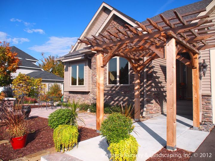 A beautiful space is created at the homes entrance.  The space is a transition zone that leads to the front yard patio or front door.