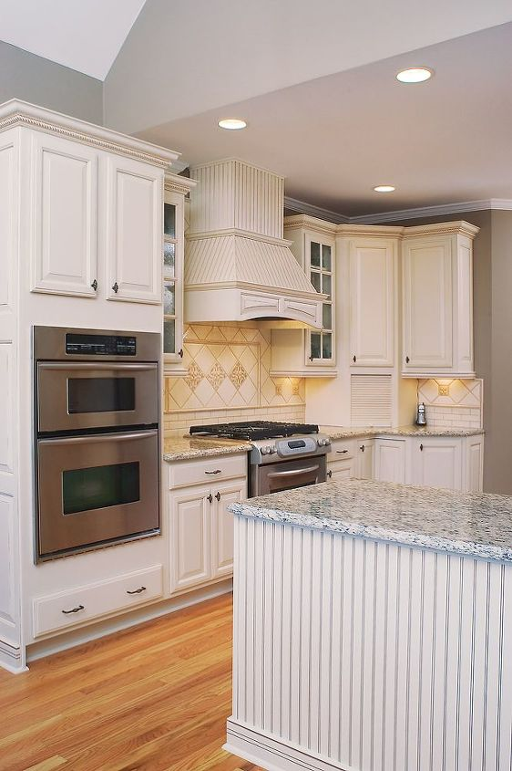 The Kitchen After - Six recessed cans and four halogen under-cabinet lights were sufficient lighting for the space with the dropped ceiling and all the light colored appointments.