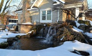 winter waterfall in the snow, outdoor living, patio, ponds water features, This is our display pond at waterfall at our Design Center Deck and Patio company runs this all winter long During hard freezes there is a lot of ice which lowers the water level in the pond