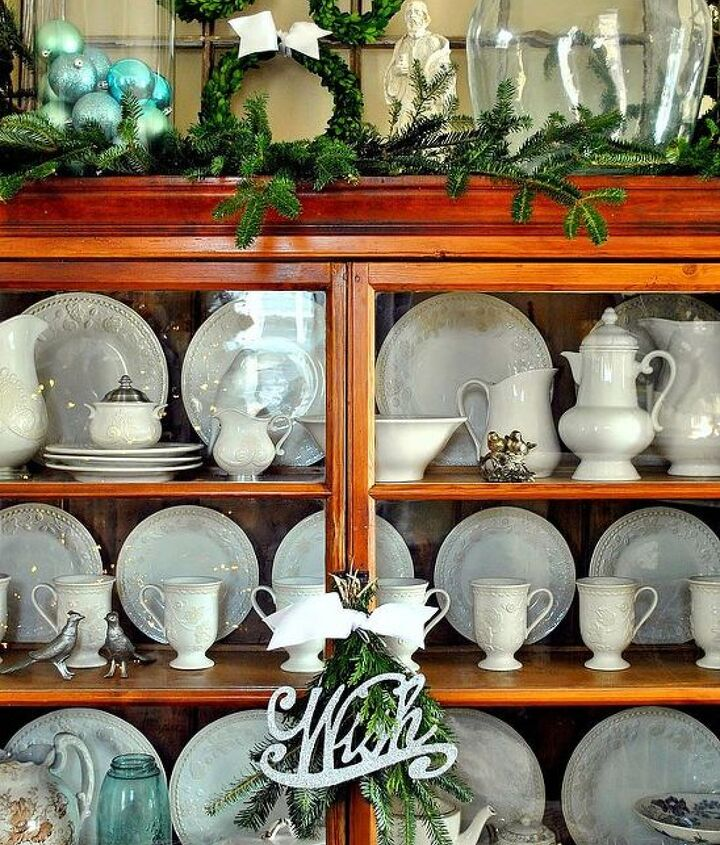 my favorite cabinet all decked out for christmas, christmas decorations, kitchen cabinets, seasonal holiday decor, wreaths